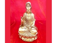brass guanyin sitting on a lotus flower